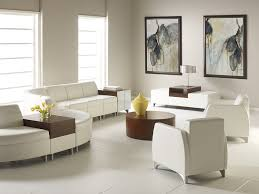 office seating area. Sweeping Curvilinear Shapes, Sleek Functional Benches, And Relaxing Stylish Lounge Chairs Create Distinctive Areas Office Seating Area