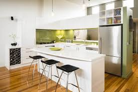 white kitchen with green splashback
