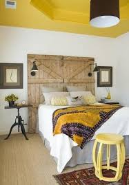 modern bedroom decor colors. yellow ceiling and bedroom decor, salvaged wood bed headboard, modern decorating ideas decor colors