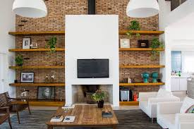 8 tv wall design ideas for your living room a real fireplace sits beneath