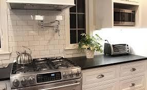 black granite countertops with tile backsplash black countertop white marble backsplash tile