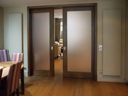 sliding wooden frame door with frosted glass home depot interior doors and laminate flooring and brown