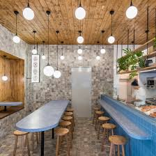 Sans-Arc Studio updates traditional fish and chip shop decor with terrazzo,  timber and tiles