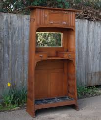english arts and crafts cabinet with hand hammered copper strap hinges possibly liberty
