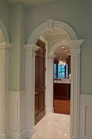 view this great traditional hallway with chair rail arched doorway by signature design
