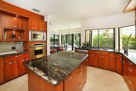 T Kitchen With Black Spice Countertops Red Mahogany Cabinets And Tropical  Style