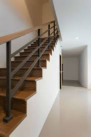 modern wood and iron stairway hand railing