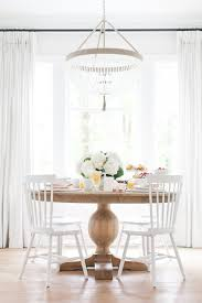 dining es loving these cosy dining es full of light sea breezes floating sheers gorgeous light ings fresh flowers and inviting table