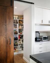 View in gallery Walk-in pantry with a sliding barn door