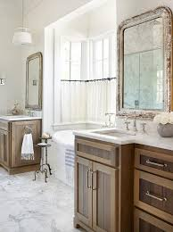 stained oak bath vanity cabinets with distressed mirrors