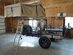 robert hill has a nice example of mounting his tent unit on a trailer rack with room underneath for a atv or bov s trailers atv
