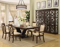 dining room traditional formal room round maroon stained wooden table rectangle brown varnished wood one