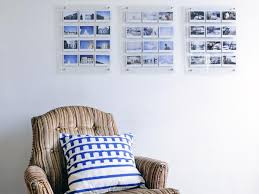 striped armchair and photographs on pictures into wall art with turn instant photos into eye catching wall art hgtv
