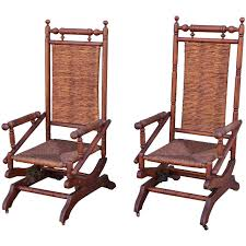 pair of rustic 19th century platform rocking chairs for