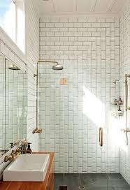 bathroom with white subway tile and gray grout bright yellow wall paint dark green sliding wardrobe door integrated wooden bedside table brown brick wall