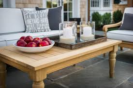 Creative Idea:Outdoor Patio With White Sofa And Grey Cushion Near Brown  Wood Coffee Table