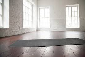 i love this yoga studio design with white brick walls and refurbished wood flooring so