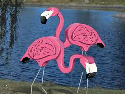 big 3d flamingos are a fun statement for a tropical or coastal outdoor setting