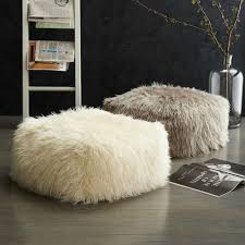 faux mongolian lamb pouf from west elm