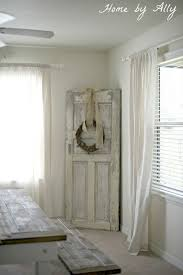 old door with wreath dress up for any holiday or season love over at home by ally