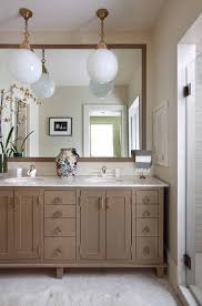 white round matte glass pendants over vanity for an eclectic atmosphere