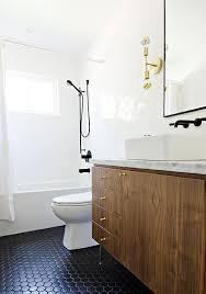 veneer washstand with black hex tile floor