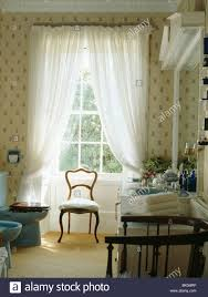 Patterned Curtains For Living Room Patterned Curtains With Voile Drapes In A Red Economy Style