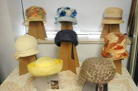 The museum has a display of spring hats set up in one of its rooms.