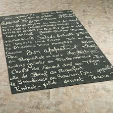 chic kitchen rugs with french writing in dark green base