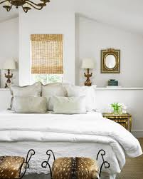 White Master Bedroom with Animal Print Stools