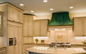 lighting in the house. replacing one florescent light with individual can lights will insure the entire room has sufficient lighting in house