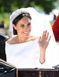 meghan ss of sus leaves windsor castle in the ascot landau carriage during a procession after
