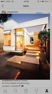 Australian architect Philip Stejskal has equipped this white timber  extension with shutters and sliding panels that camouflage with the walls  when closed.