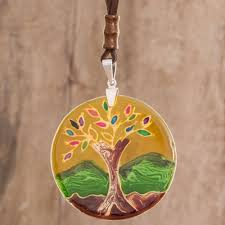 tree themed glass pendant necklace in yellow from costa rica tree of life at sunrise
