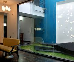 modern house design with beautiful wall details in india glass door
