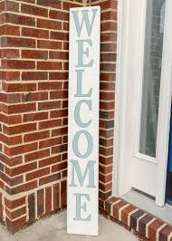 diy wood welcome sign on the front porch with decoart sky blue