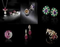 an assortment of earrings finger rings and pendant sets the versatile diamond accessories are crafted in 18k yellow gold with diffe stones like rubies