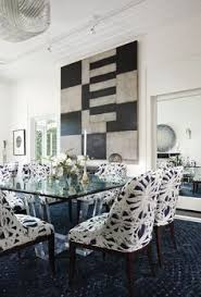 ym antiques unique chandelier pairs with track lighting to illuminate every trere in this dining