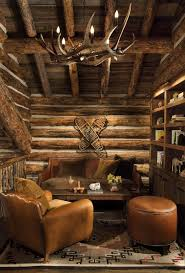 rustic log cabin interiors family room rustic with leather chair l listed chandeliers