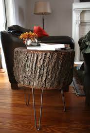 we snapped a ton of photos of the table in it s new home as a side table between our two couches in the family room