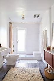 modern elements blend with rustic materials in the bath including an open tile shower