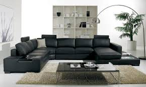 modern mini living room design with black leather sofa and glass furniture table stainless steel legs plus arch lamp wooden bookshelf ceramic floor tiles