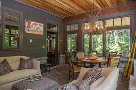 ... Appalachian Branch Chandelier steals the show in this rustic sunroom  [Design: SML Contracting]