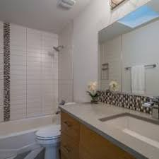 modern bathroom backsplash. Penny Round Tile Accents Add Color And Personality To Neutral Modern Bathroom Backsplash O