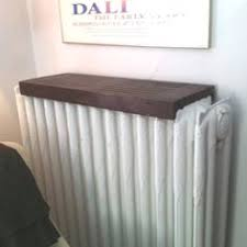 Wooden radiator cover shelf, simple and nice looking- plus maximizes