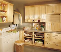 cabinets in laundry room. natural maple cabinets in a laundry room by kemper cabinetry