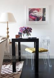 living room desk chair. living room work space features a black lacquered desk, west elm parsons desk with drawers, paired an acrylic chair gold tufted cushion