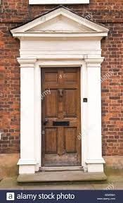 exterior door frame kits. brown wooden front door with white frame and pediment on townhouse in ludlow shropshire england uk exterior kits l