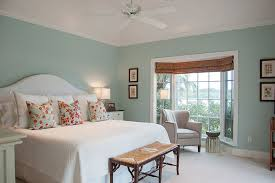 cottage guest bedroom with crown molding ceiling fan in indian