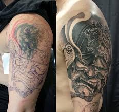 Half Sleeve Black And Grey Samurai Helmet Cover Up Tattoo Chronic Ink